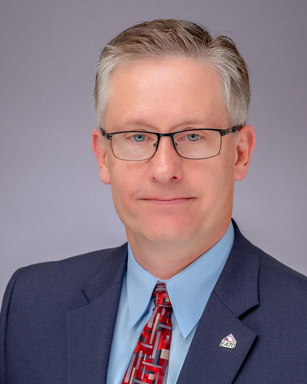 "Senior staff member Timothy E. ""Tim"" Stewart"